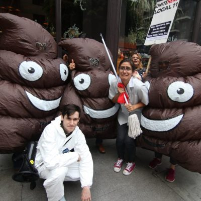 Workers in Poop Costumes Rally Outside Freehand Hotel