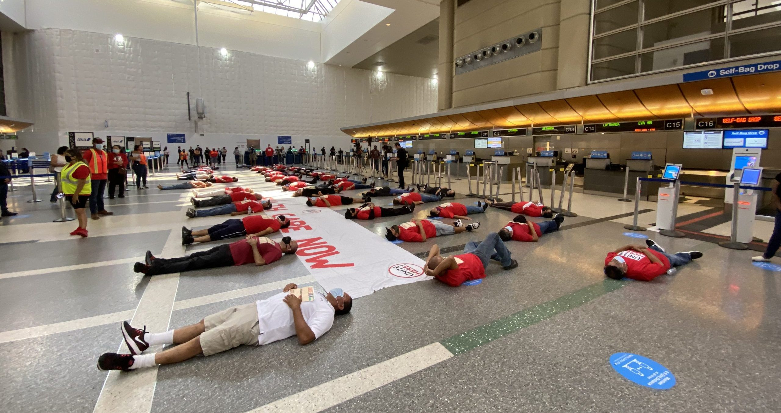 Frontline LAX Workers Stage Die-In for Extended Healthcare Amid COVID-19 Health Crisis